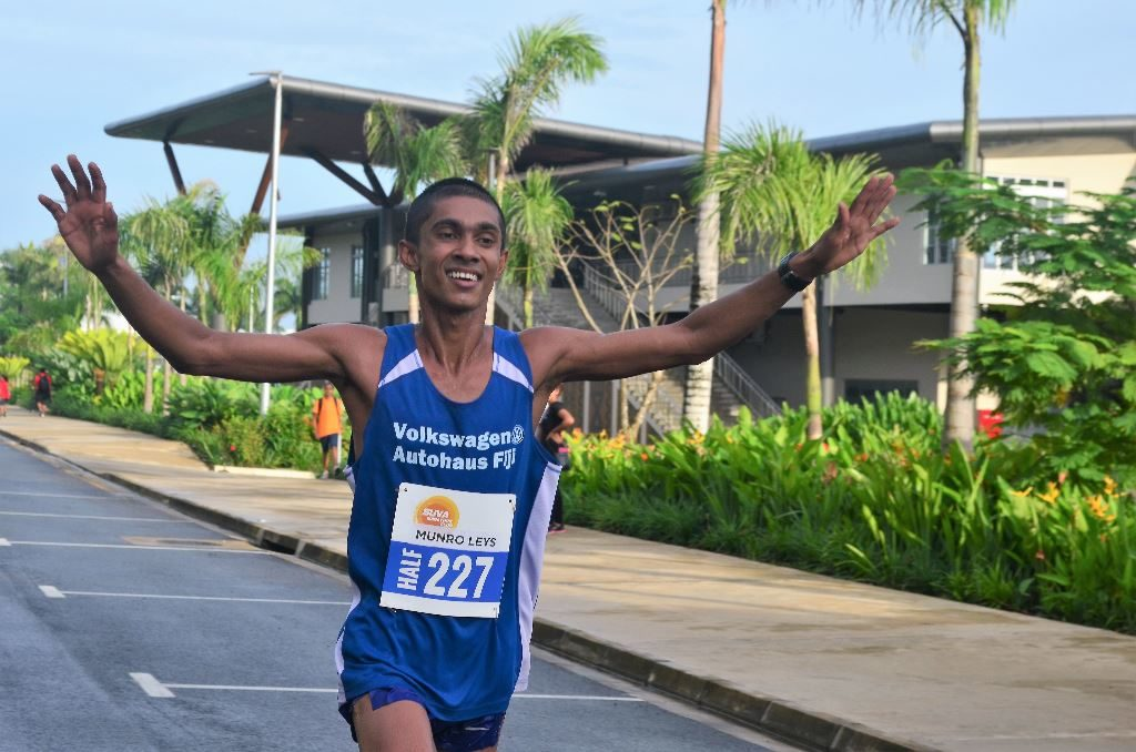Avikash Lal crossing the finish line to claim the mini marathon along Ratu Cakobau Road in Suva yeasterday. Photo: Kelvin Anthony